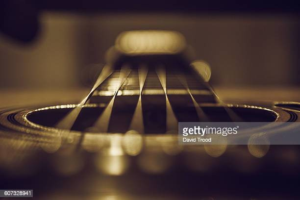 Close up of six string acoustic guitar