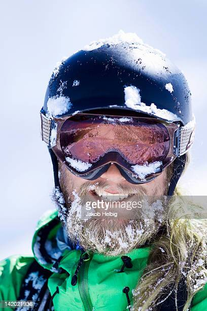 Close up of skiers snow-covered face