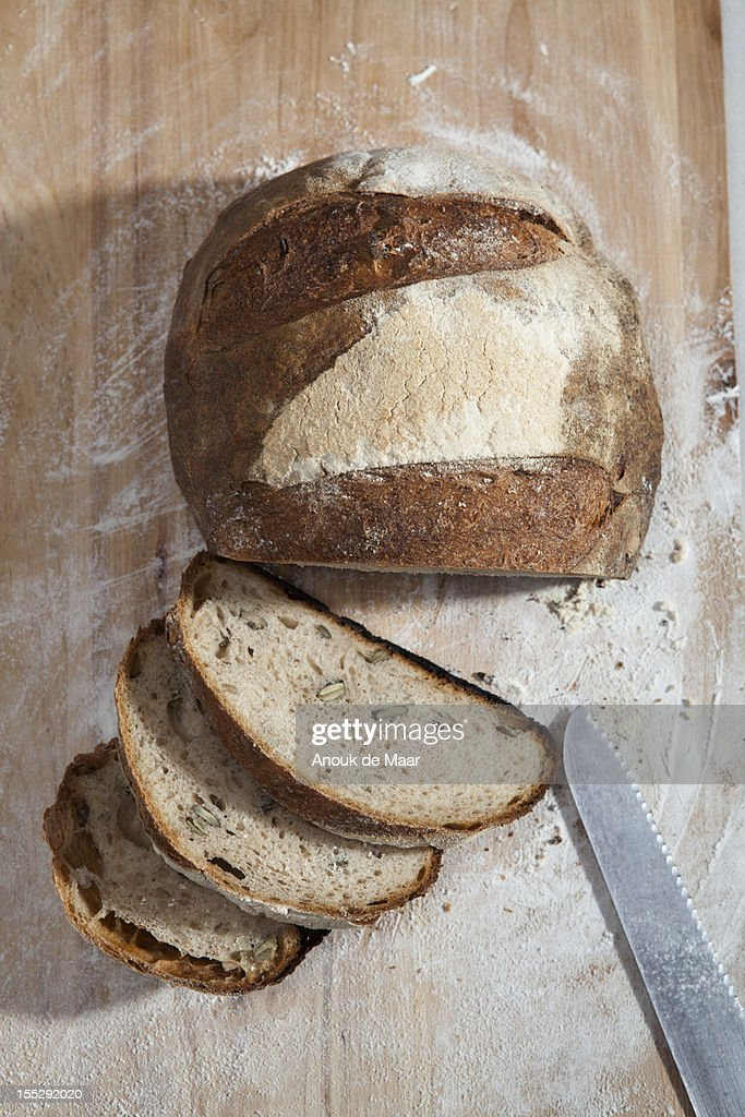 Close up of sliced loaf of bread : Stock Photo