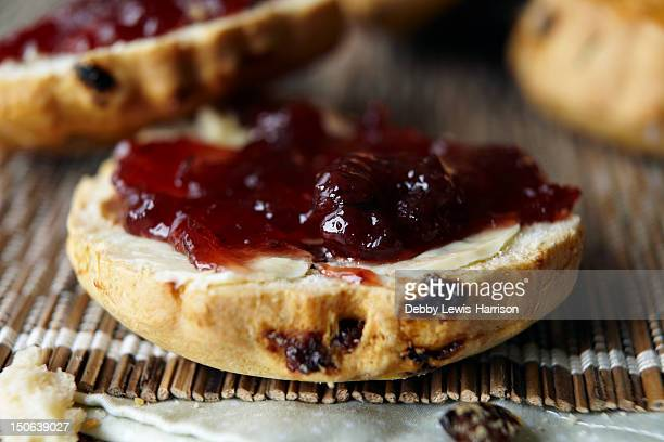 Close up of sliced scone with jam