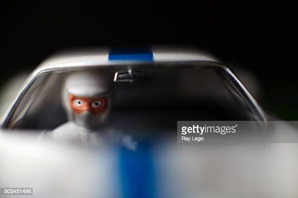 Close up of slot car driver figure.