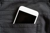 Close up of smartphone in back pocket on black pants