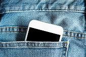 Close up of smartphone in blue pocket on black pants