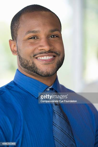 Close up of smiling businessman in office