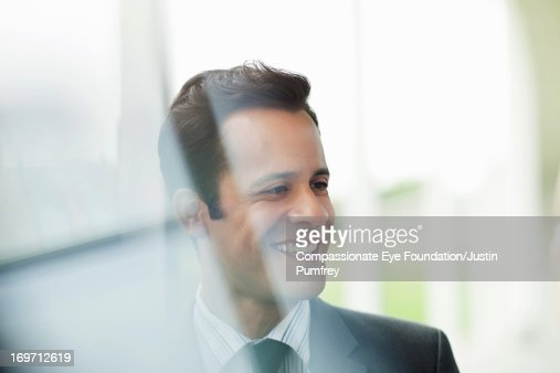 Close up of smiling businessman : Stock Photo