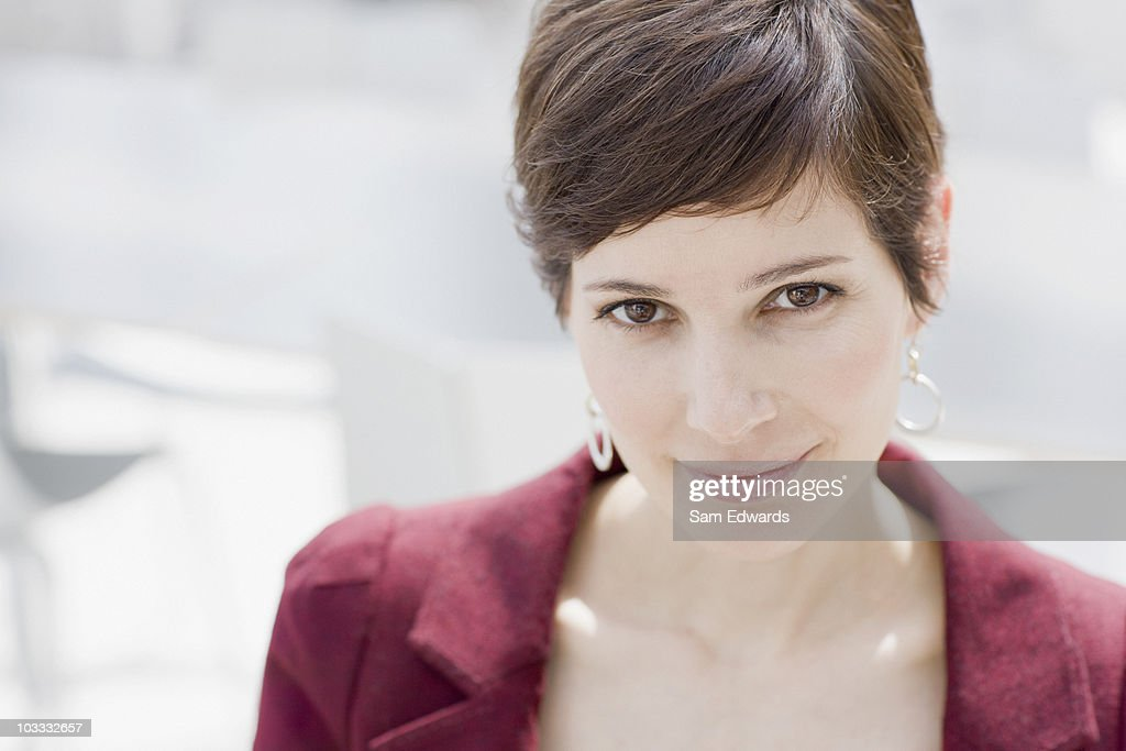 Close up of smiling businesswoman : Stock Photo