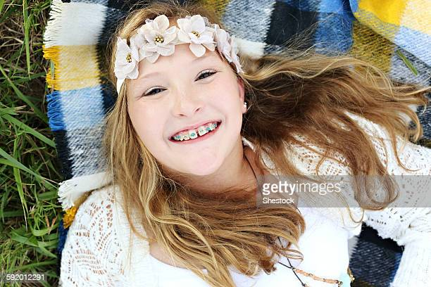 Close up of smiling Caucasian girl with flower crown and braces