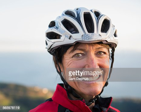 Close up of smiling Caucasian woman wearing helmet