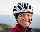 Close up of smiling Caucasian woman wearing helmet