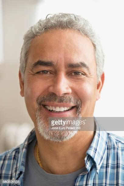 Close up of smiling Hispanic man