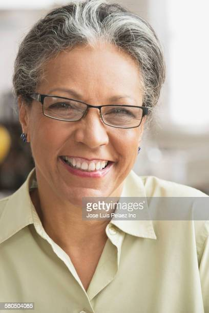 Close up of smiling Hispanic woman