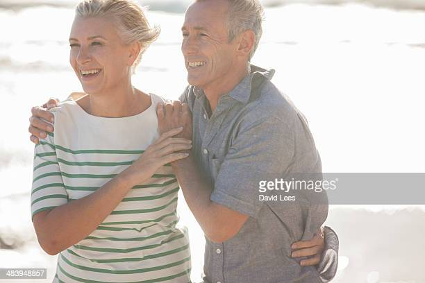 Close up of smiling mature couple on beach