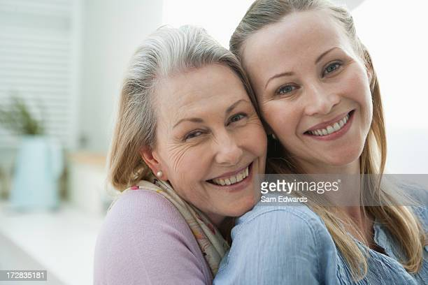 Close up of smiling mother and daughter