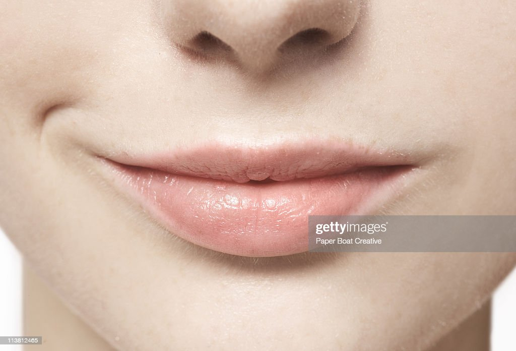 Close up of smiling, natural lips : Stock Photo