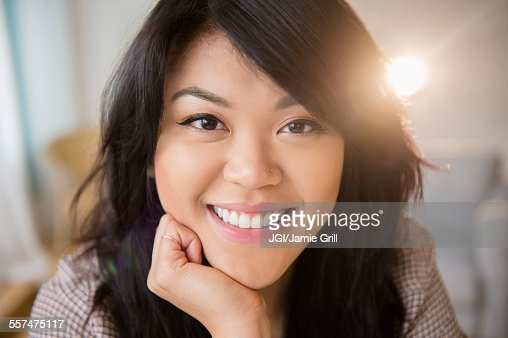 Close up of smiling Pacific Islander woman