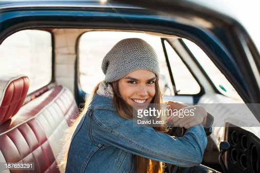 Close up of smiling woman in front of truck
