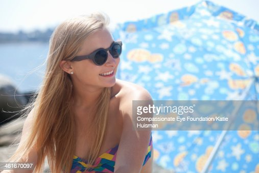 Close up of smiling woman relaxing on beach