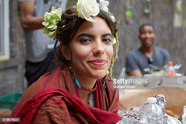 Close up of smiling woman wearing flowers and shawl