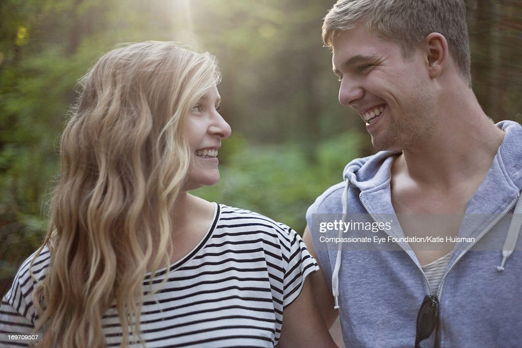 Close up of smiling young couple in woods : Stock Photo