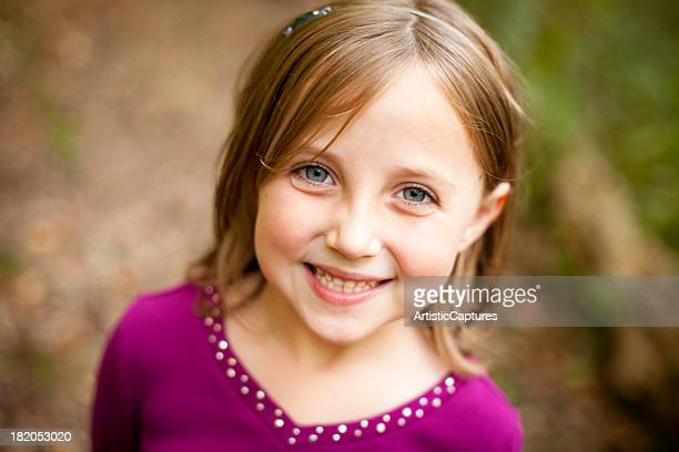 Close Up of Smiling Young Girl, in Outdoor Setting
