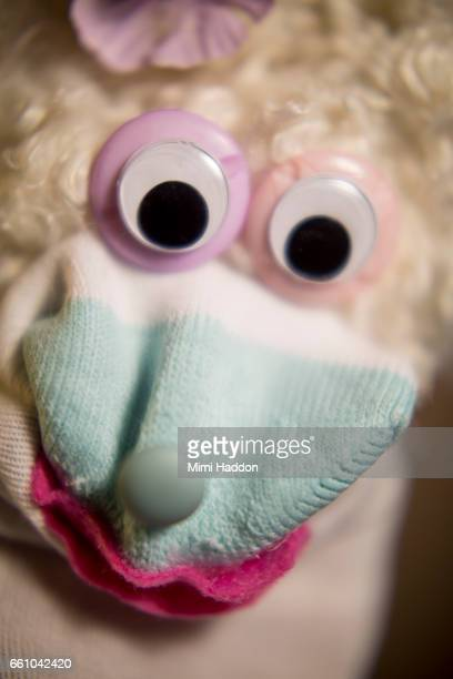 Close Up of Sock Puppet with Googly Eyes and White Curly Hair
