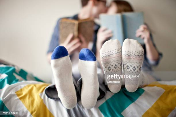 Close up of socks of couple in bed