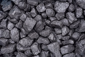 A close up of some grey dirty bricks of coal