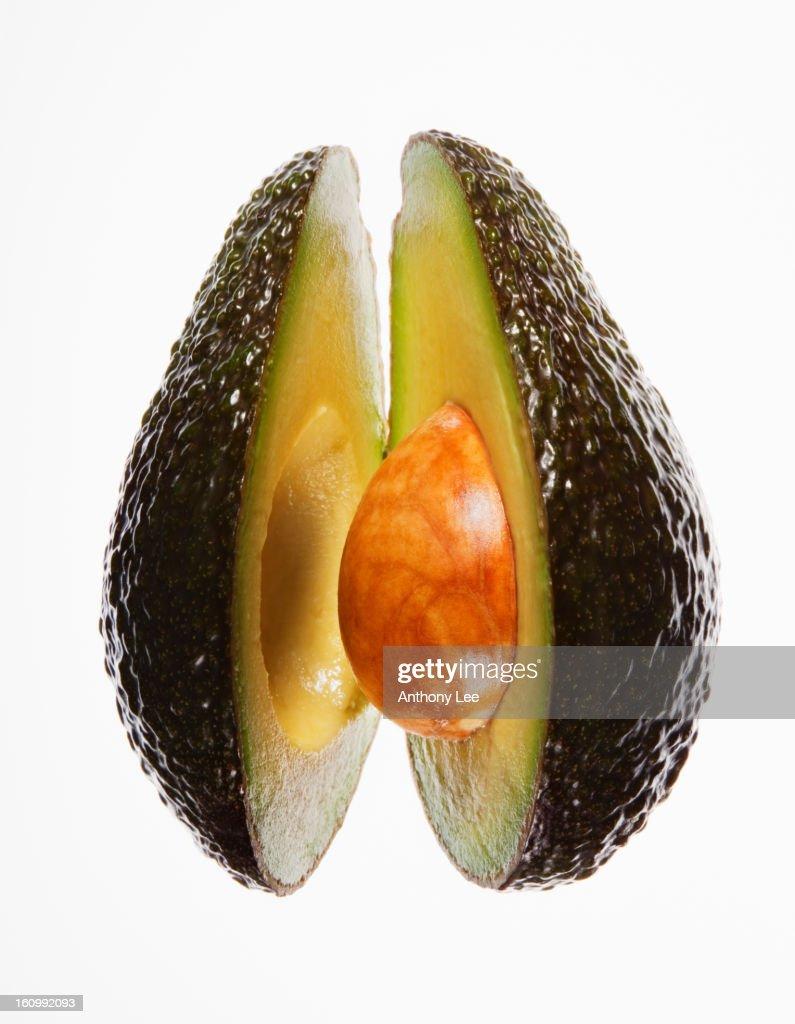Close up of split avocado : Stock Photo