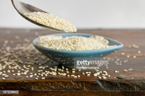 Close up of spoon of overflowing sesame seeds