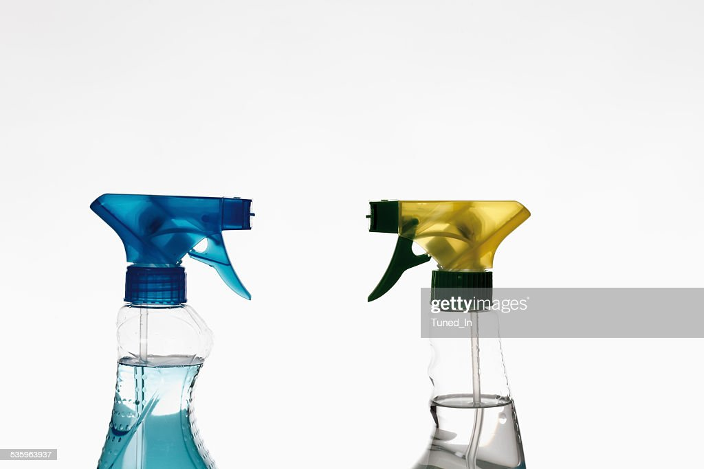 Close up of spray bottles against white background : Stock Photo