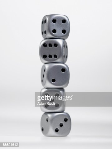 Close up of stack of silver dice : Stock Photo