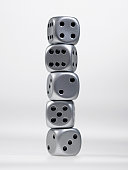 Close up of stack of silver dice