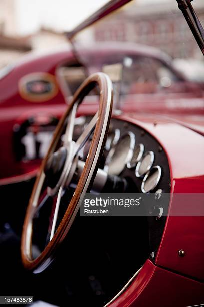Close up of steering wheel on red classic car