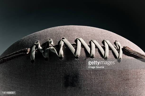 Close up of stitching on american football