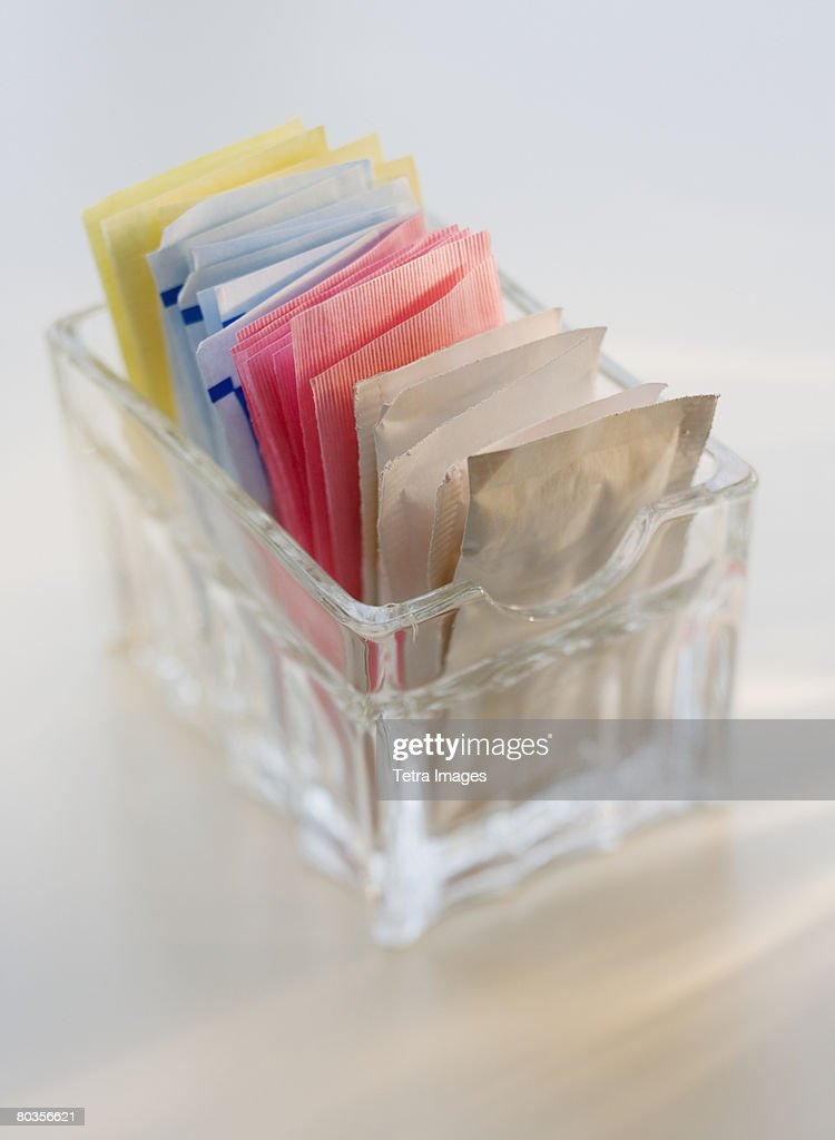 Close up of sugar and sweetener packets
