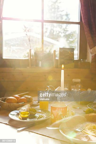 Close up of sunlit breakfast table in log cabin