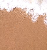 Close Up Of Surf On Sandy Beach
