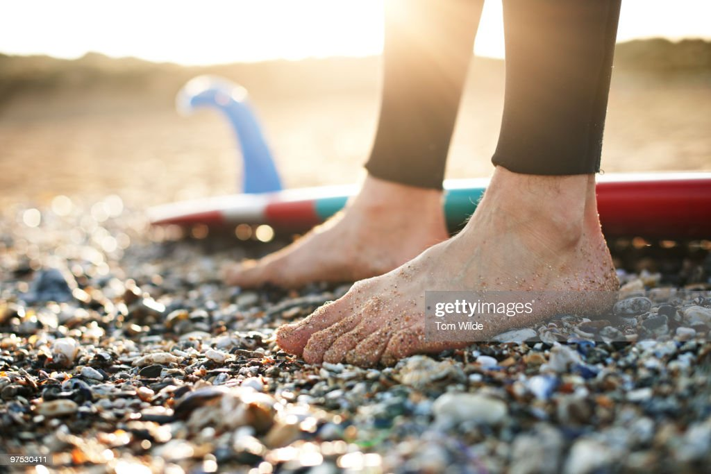 Close up of surfers feet on the beach : Stock Photo