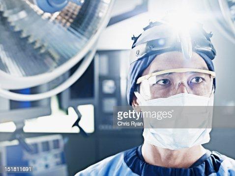 Close up of surgeon wearing headlamp