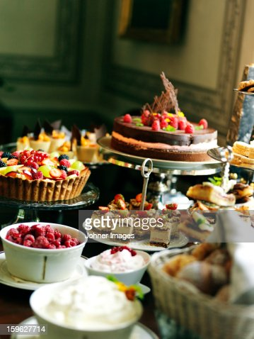Close up of table with desserts and fruit