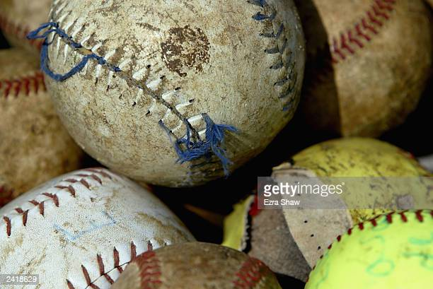 Close up of tattered baseballs and softballs the players use to practice with on August 20 2003 in Consuelo Dominican Republic Consuelo which has ten...