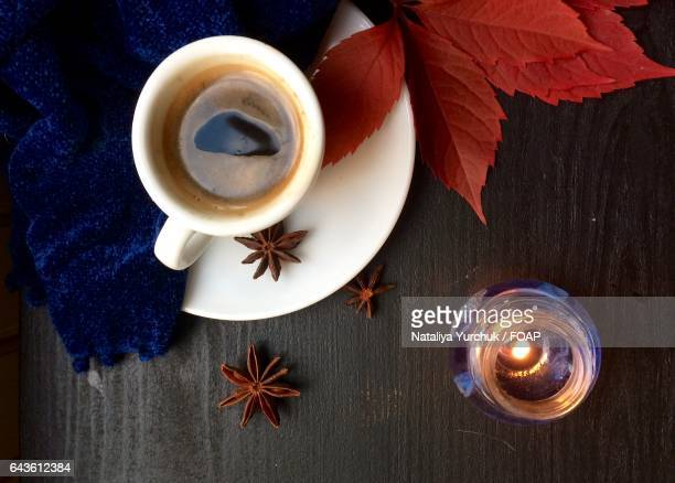 Close up of tea cup and candle