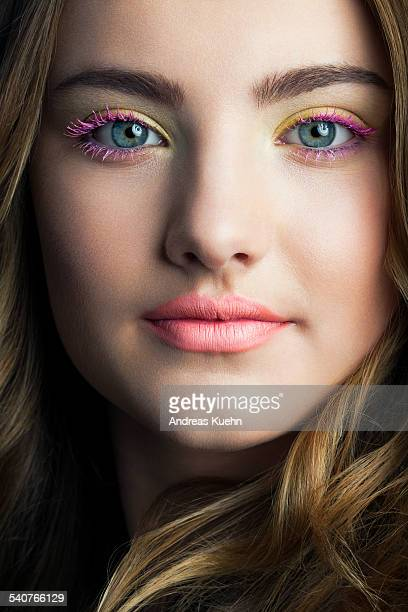 Close up of teenage girl with colorful make up.