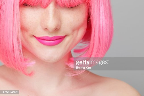 Close up of teenage girl with pink hair : Stock Photo
