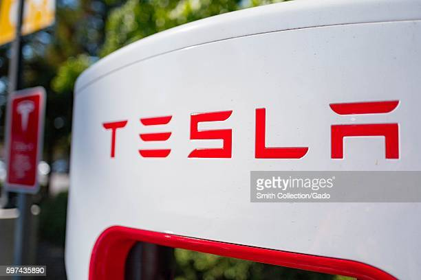 Close up of Tesla logo on a charger at a Supercharger rapid battery charging station for the electric vehicle company Tesla Motors in the Silicon...