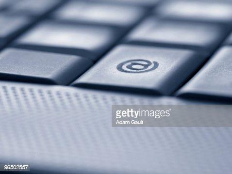 Close up of the at symbol key on computer keyboard : Stock Photo