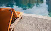 Close up of the beach lounger at swimming pool