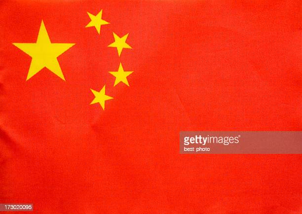A close up of the Chinese flag with its four stars