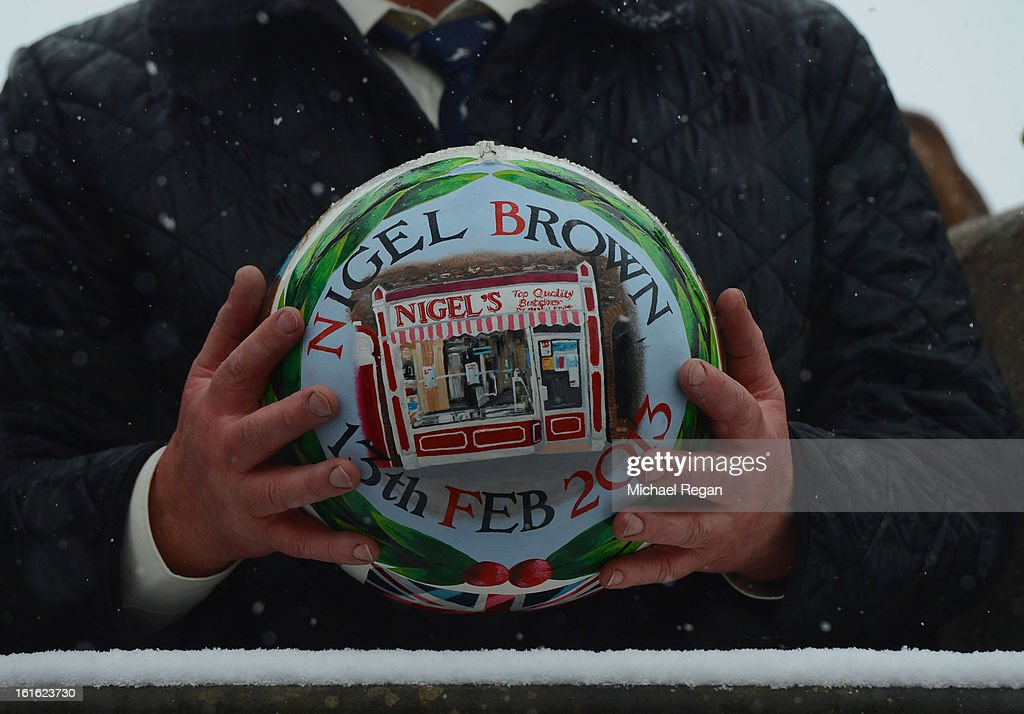 A close up of the hand-painted ball, featuring local butcher Nigel Brown's shop, before rival teams the 'Up'ards and Down'ards' battle for it during the annual Ash Wednesday 'no rules' football match on February 13, 2013, in Ashbourne, England. First played in the 17th Century between teams from opposite ends of the Derbyshire town, hundreds of participants aim to get a ball into one of two goals that are positioned three miles apart at either end of Ashboune. The match starts on Shrove Tuesday and can last until 10 PM. If a goal is scored before 6 PM, then a new ball is 'turned up' again and a new game started. If the goal is after 6 PM then the game ends for that day and continues into the next day - known as Ash Wednesday. The local butcher 'turned up' the ball today to begin play.