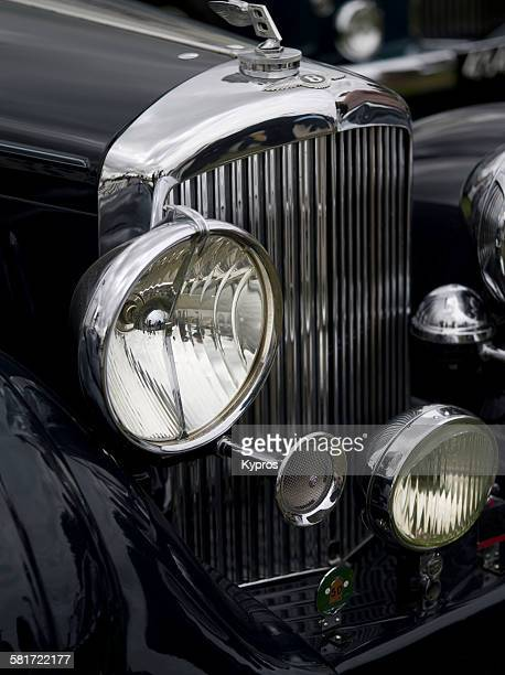 A close up of the headlight and radiator grille of a vintage Bentley Goodwood United Kingdom 12th September 2015